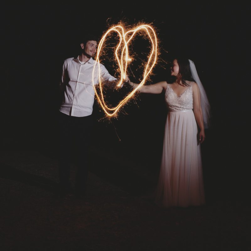 low light slow exposure artistic image of a couple at their wedding at the williams barn in san carlos California by matthew leland photography