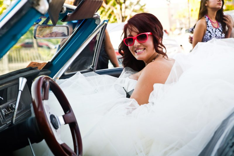 Vera Wang rock n roll bride at her wedding in a Buick Skylark during hot august nights for her reno nevada wedding by Matthew Leland Photography