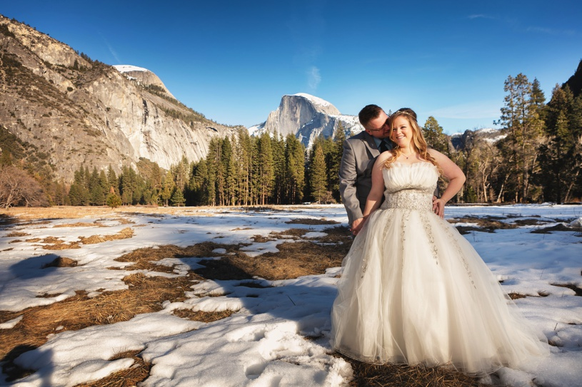 bride and groom portraits at their wedding in yosemite valley chapel at their wedding
