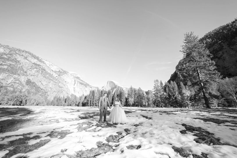 bride and groom in snow during winter wedding