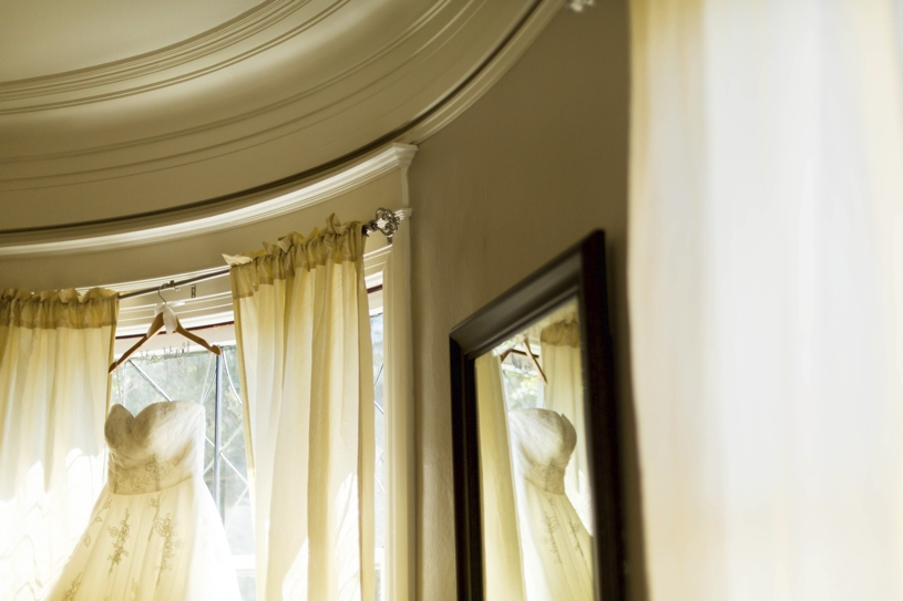 Maggie Sottero gown hanging up at Vizcaya in Sacramento for a wedding by Matthew Leland Photography