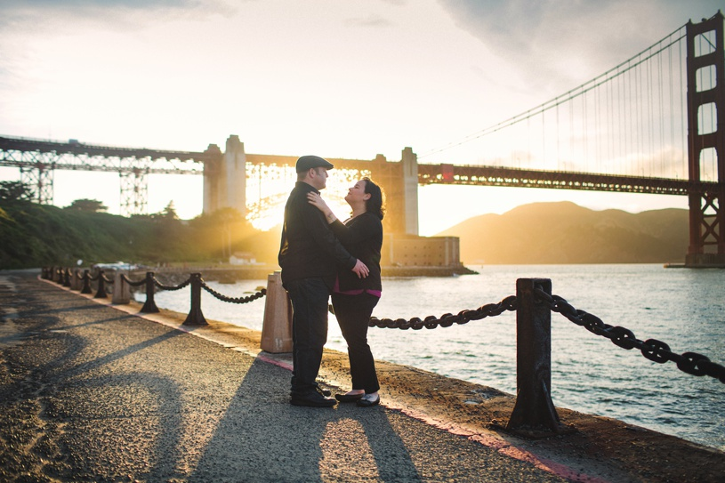 romantic couple engagment under golden gate bridge by fort by matthew leland photography