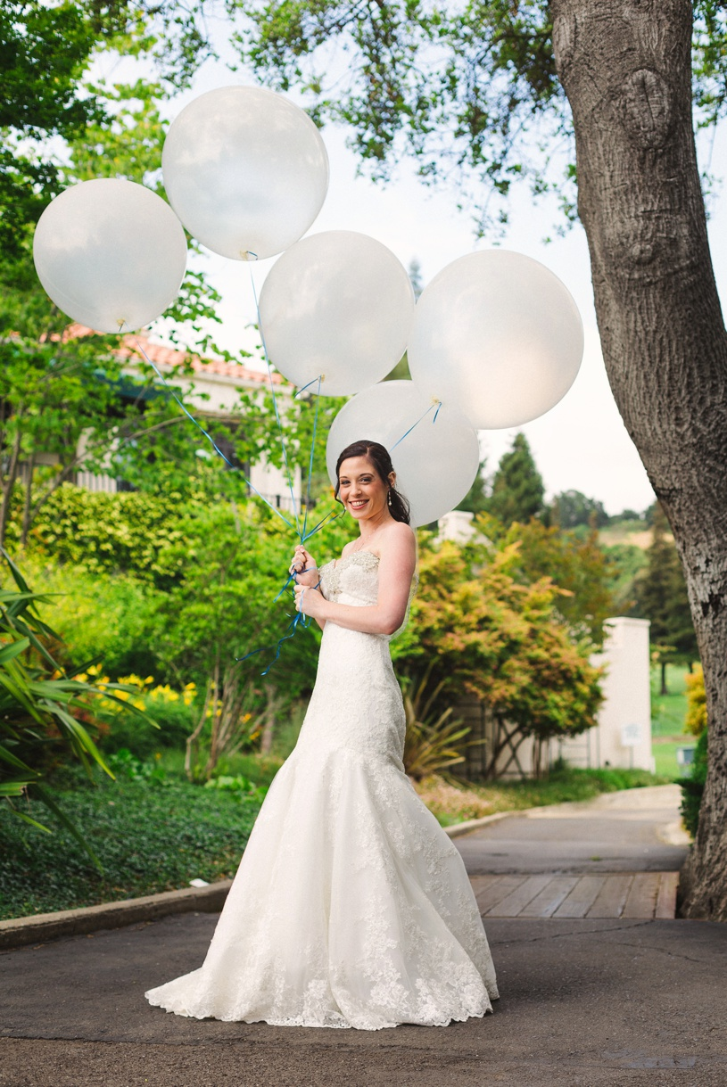 cute bride with balloons at country club wedding by matthew leland photography